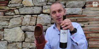 Open bottle of wine with shoe