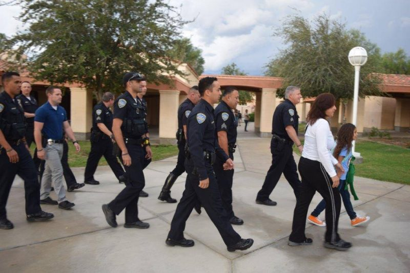 Vanessa Vega, daughter of slain officer Palm Springs Police officer Gil Vega, is escorted to school by members of the PSPD