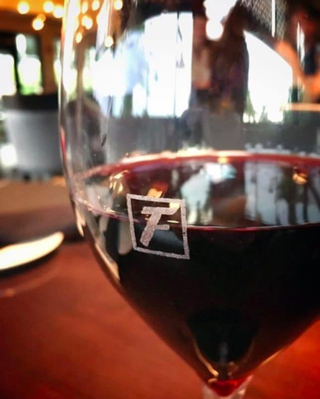 A glass of red wine served at Happy Hour at Fleming's Steakhouse in Rancho Mirage, California