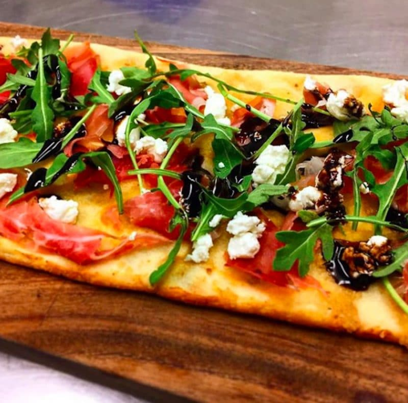 A flatbread pizza served at La Fe Wine Bar on El Paseo in Palm Desert, California