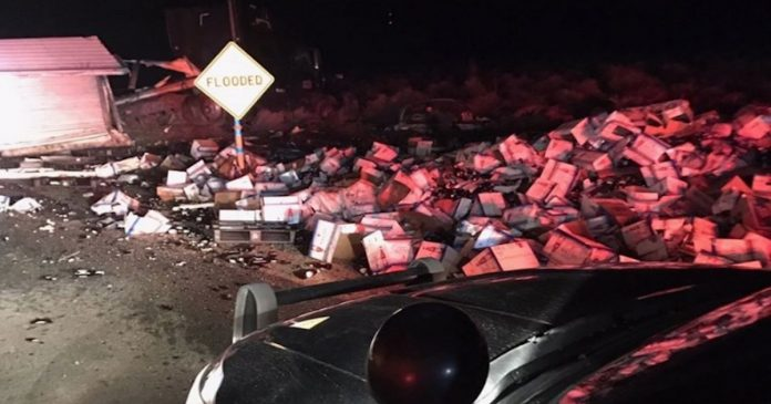 A bunch of Michelob Ultra boxes were destroyed after a truck slid on black ice. (Inyo Sheriff's Department / Facebook)