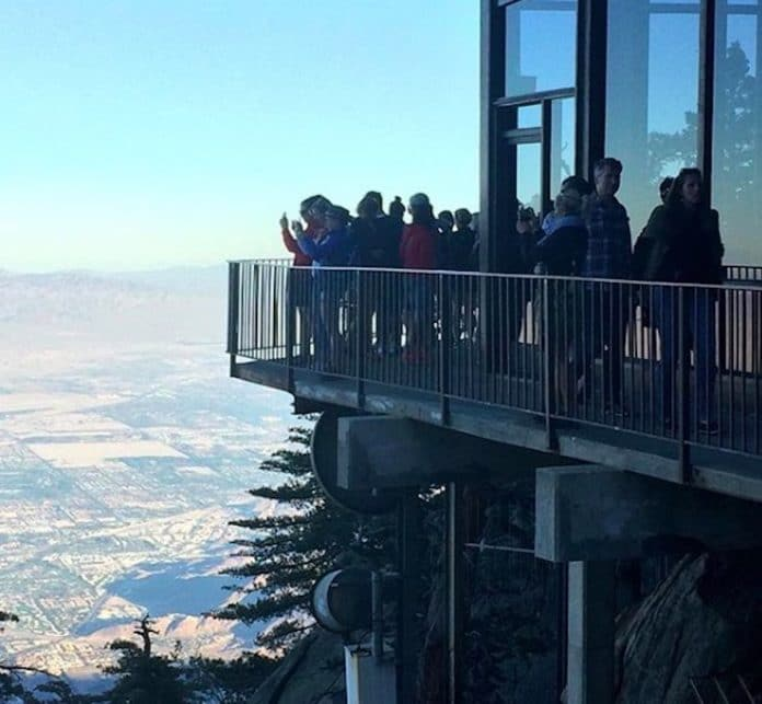 Visitors take pictures from the patio at the Palm Springs Aerial Tramway