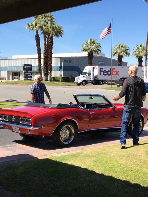 Guy Fieri and his red convertible filming for Diners, Drive-Ins, and Dives in the Palm Springs area