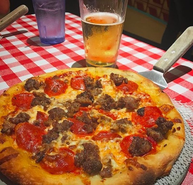 A pizza and beer served at Bill's Pizza in Palm Springs, California