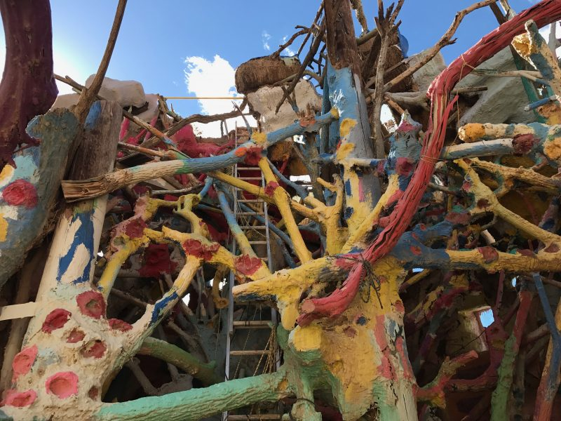 A big mess of limbs, ladders, and ropes at Salvation Mountain