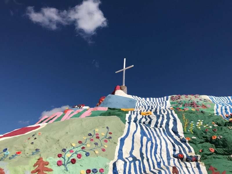 A closer photo of Salvation Mountain and the cross that tops it