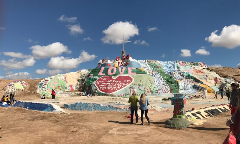 Tourists take in Salvation Mountain from afar and by walking on and through it