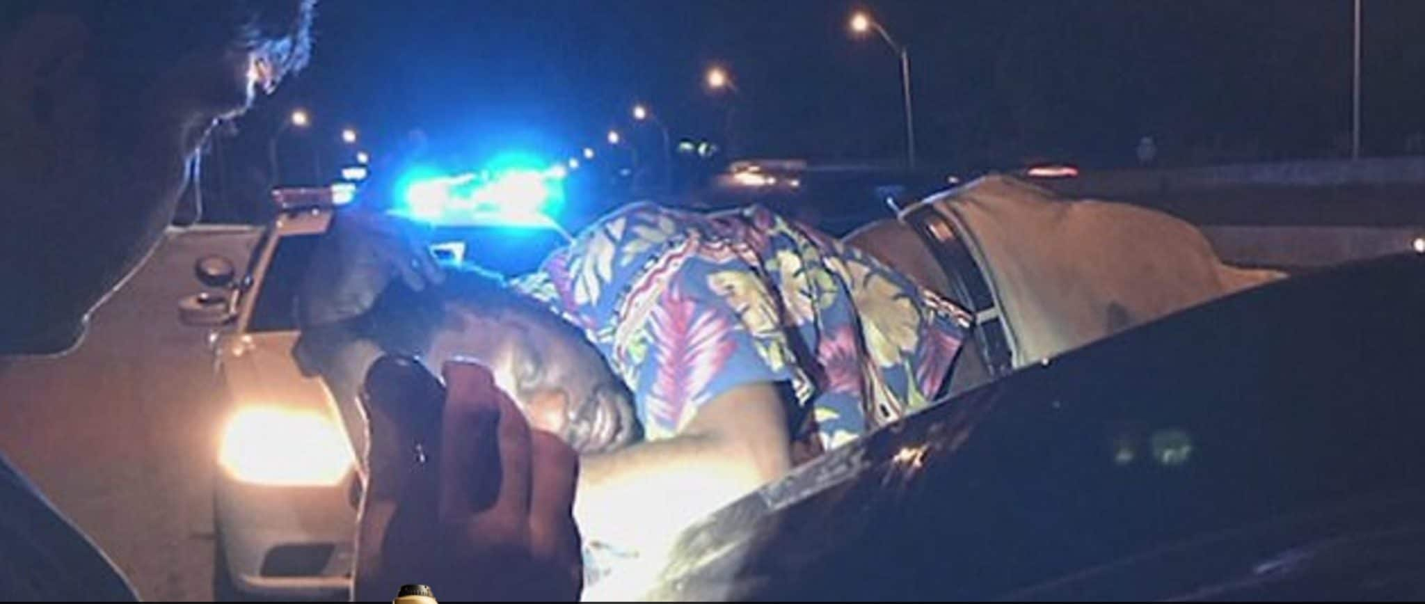 Couple drives for 14 miles with drunk man passed out on
