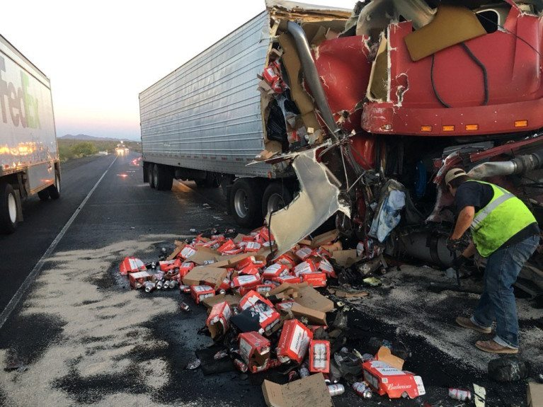 Tow truck, tour bus, and Budweiser truck collide on 10 Freeway near