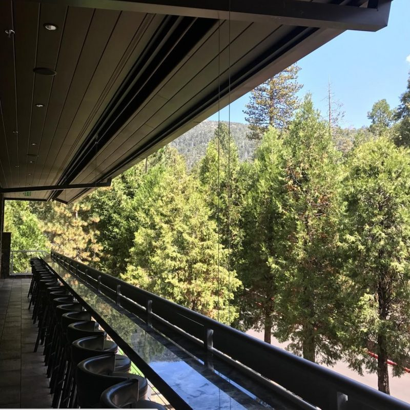 The patio at Idyllwild Brewpub looks out over tons of trees