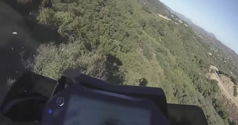 [WATCH] Motorcyclist plunges down 250 foot cliff and survives!