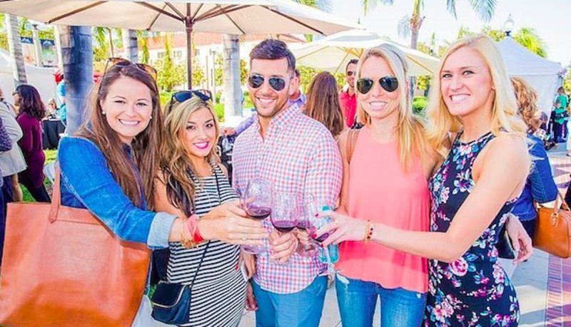 VinDiego attendees enjoy sampling wine with their discount tickets in San Diego