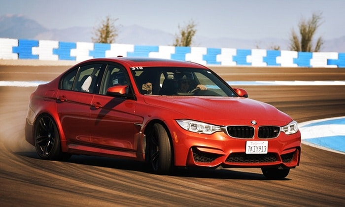 A vehicle speeds around the BMW Performance Center Driving School - where you can save up to 50% off with these coupons and codes