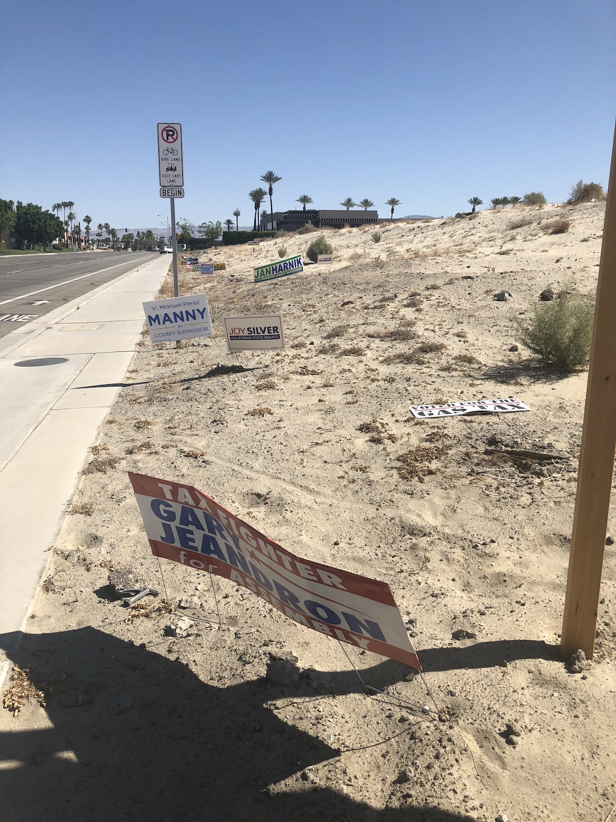 Political campaign signs seen littering Cook Street in Palm Desert, California