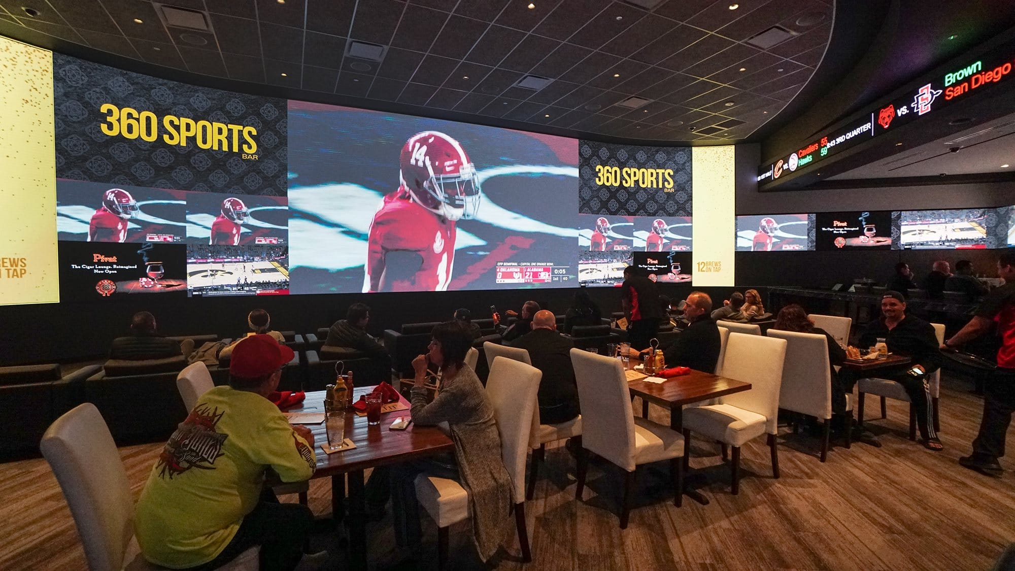 Giant screens line 360 Sports Bar at Agua Caliente Casino