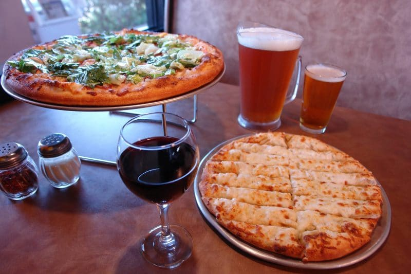 A Club Pizza, cheese bread, wine, and beer at Upper Crust Pizza in Cathedral City, California