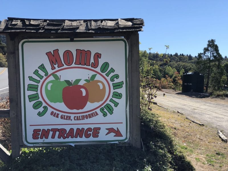A sign for Moms orchards in Oak Glen California