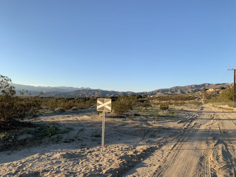 The sign greeting visitors to the Desert X art installation Ghost Tree in Desert Hot Springs